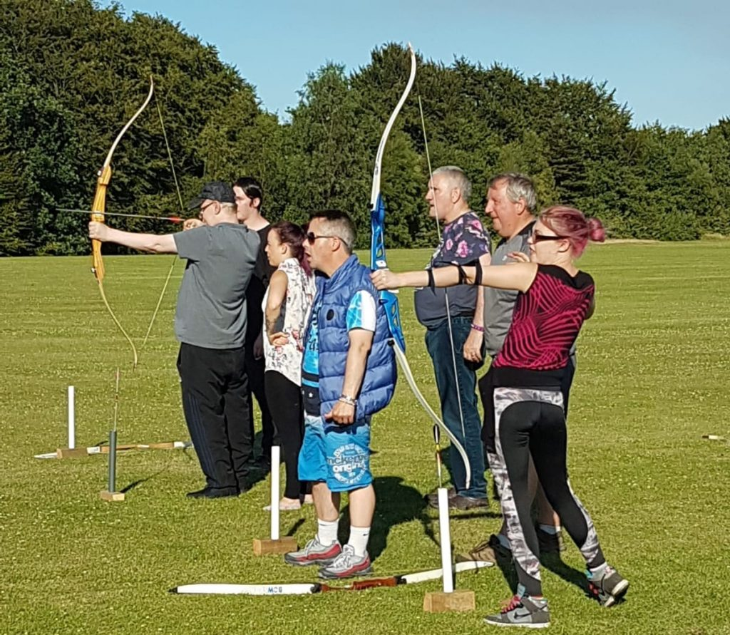 Residents at archery class