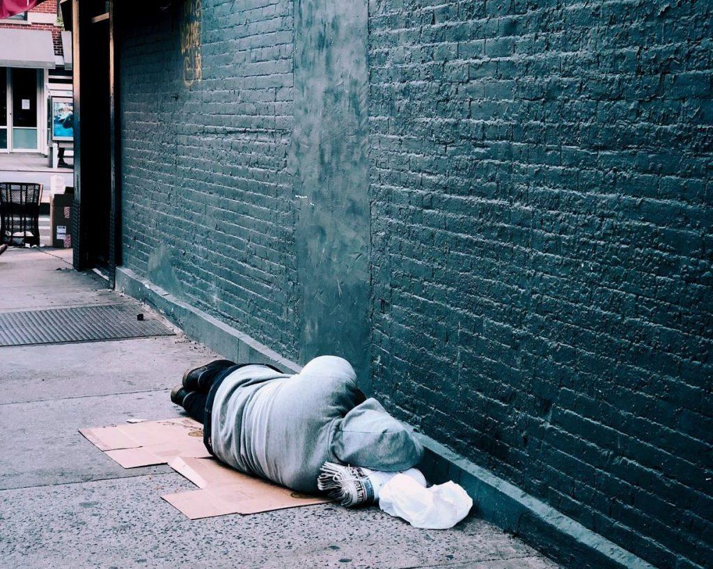 Homeless man sleeping on the streets