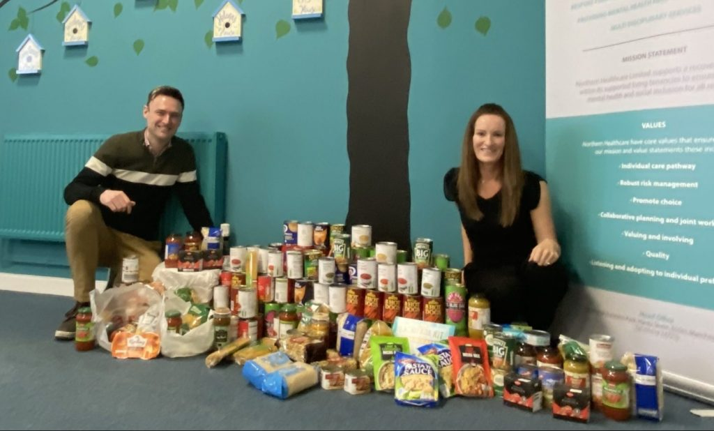 Directors next to Food Bank Donations